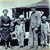 Alfred Sr and Marthea with sons, Henry (far right), William, Alfred Jr (standing on car with the wild blonde hair) and Earl (the baby with Marthea).  They are all posed with their first automobile, a 1923 Overland